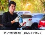 asian men holding technical... | Shutterstock . vector #1023644578