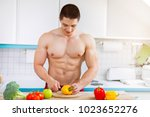 young man preparing healthy... | Shutterstock . vector #1023652276