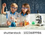 curious children in goggles... | Shutterstock . vector #1023689986