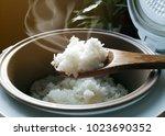 jasmine rice cooking in... | Shutterstock . vector #1023690352