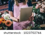 young girl takes pictures of...   Shutterstock . vector #1023702766