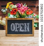 open sign on wooden table among ...   Shutterstock . vector #1023702802