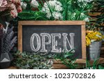 open sign on wooden table among ...   Shutterstock . vector #1023702826