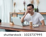 asia casual man cover face with ...   Shutterstock . vector #1023737995