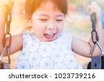 happy little asian girl on... | Shutterstock . vector #1023739216