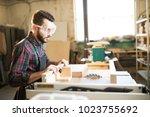 young handsome caucasian... | Shutterstock . vector #1023755692