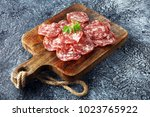 thinly sliced salami on a... | Shutterstock . vector #1023765922