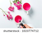person pouring tea with rose...   Shutterstock . vector #1023774712