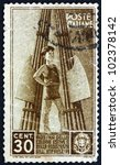 Small photo of ITALY - CIRCA 1937: a stamp printed in the Italy shows Child and Fasces, circa 1937