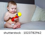 adorable child with colorful... | Shutterstock . vector #1023782962