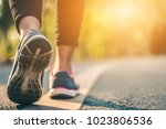 women runner feet on road in...   Shutterstock . vector #1023806536