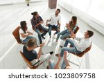 creative team holds a meeting... | Shutterstock . vector #1023809758