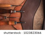 set of leather craft tools on... | Shutterstock . vector #1023823066