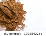 pile cocoa powder in a scoop... | Shutterstock . vector #1023842266