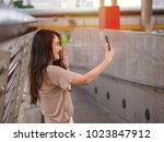 young asian woman making a... | Shutterstock . vector #1023847912