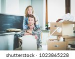 portrait of young couple moving ... | Shutterstock . vector #1023865228