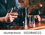 close up details of barman... | Shutterstock . vector #1023868222