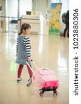 Small photo of Elementary school girl with carry back