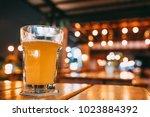 one pint of beer on restaurant... | Shutterstock . vector #1023884392