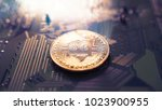 bitcoin symbol and electrical... | Shutterstock . vector #1023900955