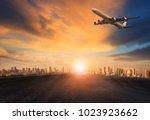 passenger plane flying over... | Shutterstock . vector #1023923662