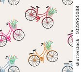 seamless pattern. bicycles ... | Shutterstock .eps vector #1023935038