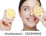 young woman holding lemon slice ... | Shutterstock . vector #102394042