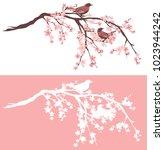 birds sitting on blooming...   Shutterstock .eps vector #1023944242