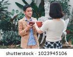 girlfriend preparing to gift... | Shutterstock . vector #1023945106