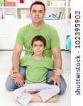 Father and son spending time together at home - stock photo