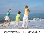 three happy children running on ... | Shutterstock . vector #1023970375