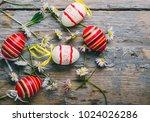 easter eggs and spring daisy... | Shutterstock . vector #1024026286