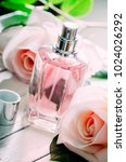 bottle of perfume and pink... | Shutterstock . vector #1024026292