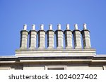 eight chimneys in a row ... | Shutterstock . vector #1024027402