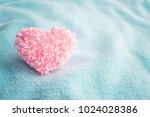 fluffy pink thread heart on... | Shutterstock . vector #1024028386
