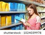 young woman choosing baby food... | Shutterstock . vector #1024039978