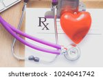 a medical stethoscope near a...   Shutterstock . vector #1024041742