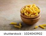 raw fusilli pasta in a wooden...   Shutterstock . vector #1024043902