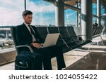young business man sitting on... | Shutterstock . vector #1024055422