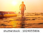child running to the sea and... | Shutterstock . vector #1024055806