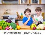 healthy eating. happy children... | Shutterstock . vector #1024073182