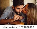 couple sharing orange juice.... | Shutterstock . vector #1024078132