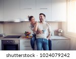 romantic young couple cooking... | Shutterstock . vector #1024079242