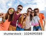 hugging cheerful young people... | Shutterstock . vector #1024090585