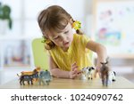 child girl playing with animal... | Shutterstock . vector #1024090762