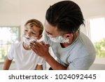 man applying shaving foam in... | Shutterstock . vector #1024092445
