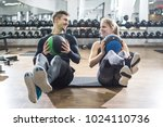 fit couple doing abdominal...   Shutterstock . vector #1024110736