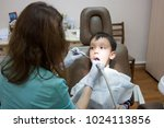 dentist is treating a boy's... | Shutterstock . vector #1024113856