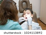 dentist is treating a boy's... | Shutterstock . vector #1024113892