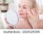 forty years old woman looking... | Shutterstock . vector #1024129258